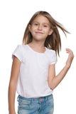 Bambina sorridente con capelli scorrenti Immagine Stock