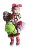 Bambina su un fondo bianco Fotografia Stock
