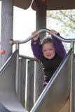 Bambina su una trasparenza fotografie stock