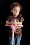 Bambina sul motorino Immagine Stock