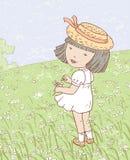 Bambina sul prato delle camomille Immagini Stock