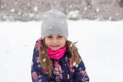 Bambina sulla neve Immagine Stock