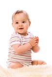 Bambina sulla pelle di pecora Fotografia Stock