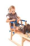 Bambina sulla slitta in studio Immagine Stock Libera da Diritti