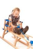 Bambina sulla slitta in studio Immagini Stock