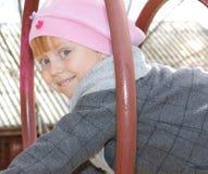 Bambina sulla terra del gioco Fotografia Stock Libera da Diritti