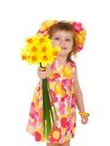 Bambina sveglia che dà i fiori Immagine Stock