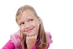 Bambina sveglia che osserva alla destra Fotografie Stock