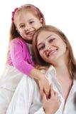 Bambina sveglia e la sua madre Immagine Stock