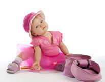 Bambina sveglia nel colore rosa Immagini Stock