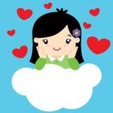 Bambina sveglia nell'amore che si siede su una nuvola Immagine Stock Libera da Diritti