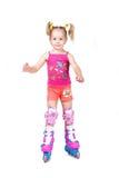 Bambina sveglia pattinare di rullo isolata su bianco Fotografia Stock Libera da Diritti