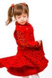 Bambina sveglia in vestito rosso fotografia stock