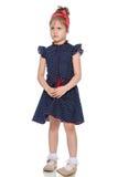Bambina timida nel vestito blu Immagine Stock