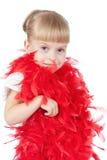 Bambina in un boa rosso Immagini Stock Libere da Diritti
