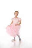 Bambina in un vestito elegante dentellare. immagini stock