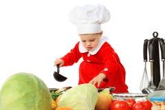 Bambina in una protezione del cuoco Immagine Stock Libera da Diritti