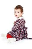 Bambina in vestito checkered fotografie stock libere da diritti