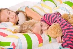 Bambini addormentati svegli fotografia stock