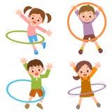 Bambini al hula-hoop Fotografia Stock