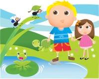 Bambini al lago/stagno Fotografie Stock