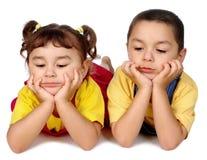Bambini annoiati che osservano giù Immagine Stock Libera da Diritti