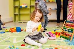 Bambini che giocano con i giocattoli Fotografia Stock Libera da Diritti