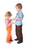 Bambini che giocano medico Fotografie Stock