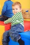 Bambini che giocano nell'asilo Immagine Stock Libera da Diritti
