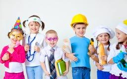 Bambini che giocano nelle professioni Immagine Stock