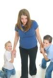 Bambini che tirano la madre Fotografie Stock Libere da Diritti