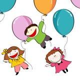 Bambini che volano sulle sfere Fotografie Stock