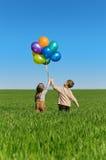 Bambini con gli aerostati Immagine Stock Libera da Diritti