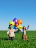 Bambini con gli aerostati Immagine Stock