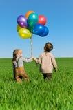 Bambini con gli aerostati Fotografia Stock Libera da Diritti