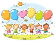 Bambini con i palloni Immagini Stock