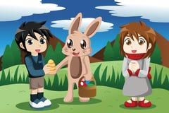 Bambini con il coniglietto di pasqua Fotografia Stock