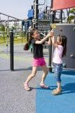 Bambini con il Lollipop al campo da giuoco Immagini Stock Libere da Diritti