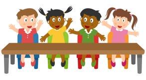 Bambini del banco nell'aula Fotografia Stock