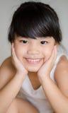 Bambini dell'Asia del ritratto che ritengono felici della ragazza della scuola Immagini Stock