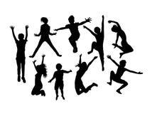 Bambini di salto felici Immagine Stock
