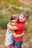 Bambini divertenti nel parco di estate Immagine Stock