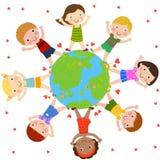 Bambini e globo Fotografia Stock