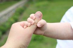 Bambini e mani dell'uomo Fotografia Stock