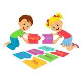 Bambini e puzzle Fotografia Stock