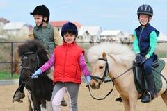 Bambini equestri Immagini Stock