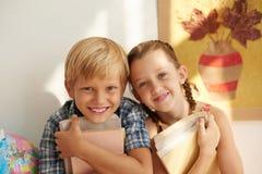 Bambini felici del banco Immagine Stock