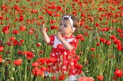 Bambini fra i fiori Immagini Stock Libere da Diritti
