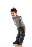 Bambini in giovane età che ridono sulla priorità bassa bianca Fotografie Stock