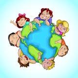 Bambini intorno al globo Fotografia Stock